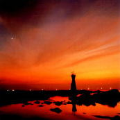 夕日と漁り火